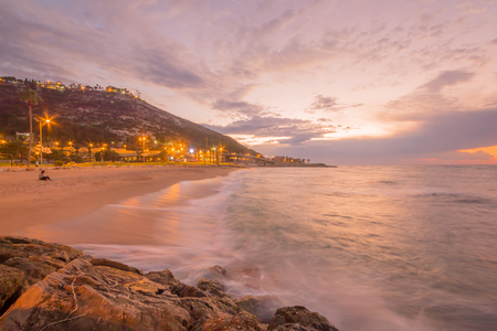 Sunset view of the Bat-Galim beach and the Carmel mountain, in Haifa, Israel Stock Photo