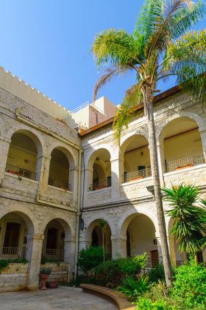 sacre coeur: HAIFA, ISRAEL - OCTOBER 27, 2017: The yard of the Sacred Heart (Sacre Coeur) monastery, now serve as a religious hospice, in Haifa, Israel