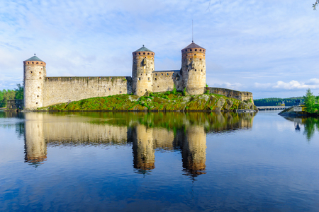 View of the Olavinlinna castle, in Savonlinna, Finland. It is a 15th-century three-tower castle Editorial