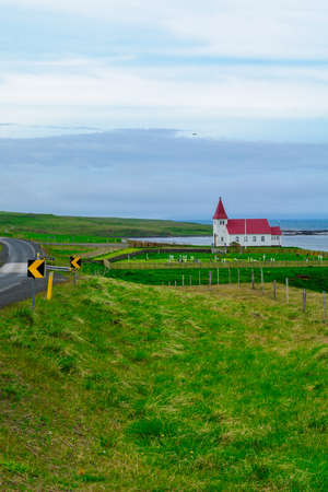 Countryside and a secluded church along the Hrutafjordur fjord, in the west fjords region, Iceland
