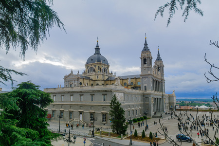 MADRID, SPAIN - DECEMBER 31, 2017: View of the Cathedral, with locals and visitors, in Madrid, Spain Editorial