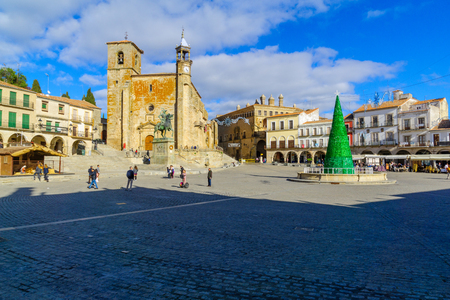 TRUJILLO, SPAIN - DECEMBER 30, 2017: Scene of Plaza Mayor, with San Martin church, a Christmas tree, locals and visitors, in Trujillo, Extremadura, Spain Editorial