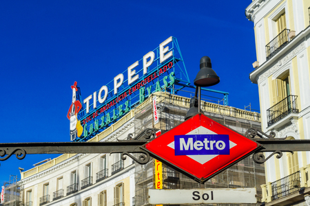 MADRID, SPAIN - JANUARY 1, 2018: View of Puerta del Sol square, with the Tio Pepe sign, and the Metro station sign, in Madrid, Spain