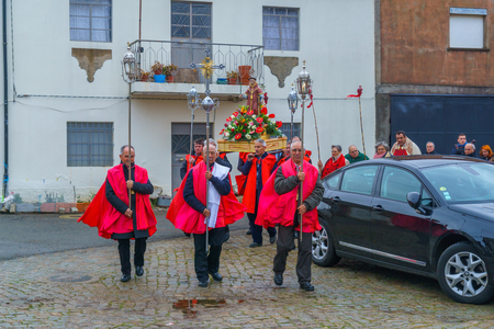 DUAS IGREJAS, PORTUGAL - DECEMBER 26, 2017: Villagers take part and circle the church, in the celebration of Santo Estevao, as part of Christmas event, in Duas Igrejas, Portugal Editorial