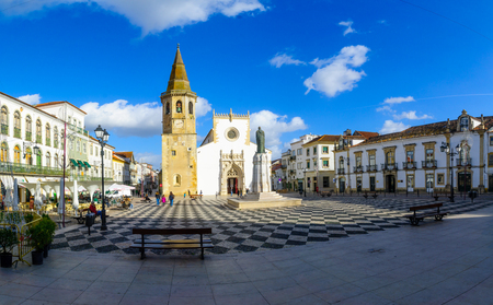 TOMAR, PORTUGAL - DECEMBER 27, 2017: Scene of the main square (praca da republica), and Saint John the Baptist church, with locals and visitors, in Tomar, Portugal