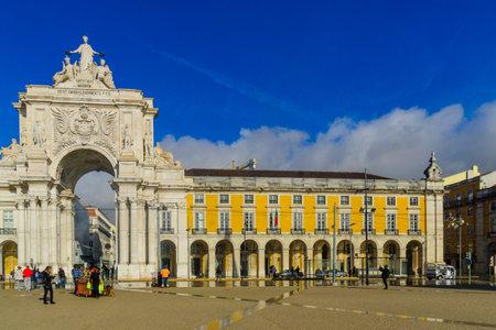 LISBON, PORTUGAL - DECEMBER 29, 2017: Scene of the Terreiro do Paco, Commerce square, with Arco da Rua Augusta, locals and visitors, in Lisbon, Portugal