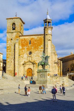 TRUJILLO, SPAIN - DECEMBER 30, 2017: Scene of Plaza Mayor, with San Martin church, locals and visitors, in Trujillo, Extremadura, Spain
