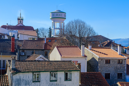 View of the village center skyline, and a water tower (with village name), in Belmonte, Castelo Branco, Portugal Stock Photo