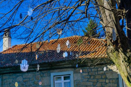 View of a tree and Hamsa symbol decorations, in Belmonte, Castelo Branco, Portugal Stock Photo