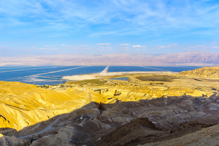 Landscape of the valley of Zohar, and salt evaporation ponds in the Dead Sea, Southern Israel Stock Photo