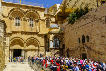 Jerusalem, Israel - April 6, 2018: Orthodox good Friday scene in the entry yard of the church of the holy sepulcher, with a crowd of pilgrims. The old city of Jerusalem, Israel Editorial