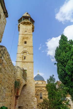 The minaret of the Mosque of Omar and the dome of the church of the Holy Sepulcher, in the old city of Jerusalem, Israel Stock Photo