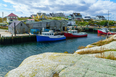 Peggys Cove, Canada - September 22, 2018: Scene of the fishing village, with wooden houses, boats and tourists, in Peggys Cove, in Nova Scotia, Canada Editorial