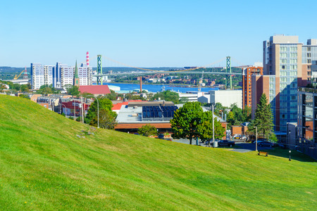 Halifax, Canada - September 23, 2018: View of downtown buildings, and the Angus L. Macdonald Bridge, in Halifax, Nova Scotia, Canada