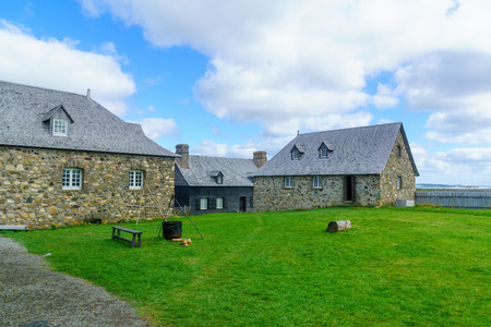 Louisbourg, Canada - September 20, 2018: Historic buildings in the fortress of Louisbourg, Cape Breton island, Nova Scotia, Canada