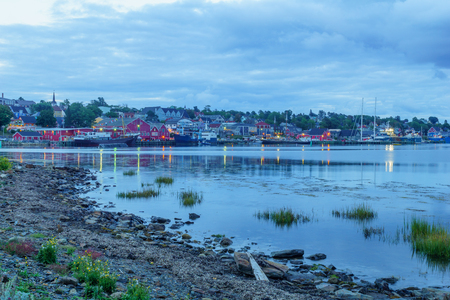 Lunenburg, Canada - September 20, 2018: Sunset view of the waterfront and port of the historic town Lunenburg, Nova Scotia, Canada