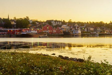 Lunenburg, Canada - September 21, 2018: Sunrise view of the waterfront and port of the historic town Lunenburg, Nova Scotia, Canada Editorial