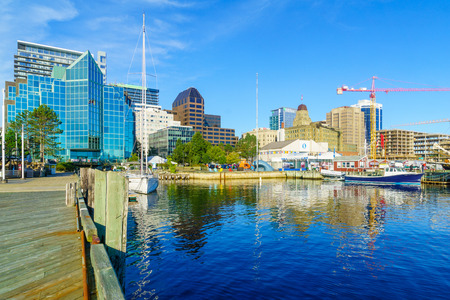 Halifax, Canada - September 23, 2018: View of the harbor and the downtown, with locals and visitors, in Halifax, Nova Scotia, Canada Editorial