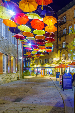 Quebec City, Canada - September 27, 2018: Night view of the Umbrella Alley in the lower town, Quebec City, Quebec, Canada