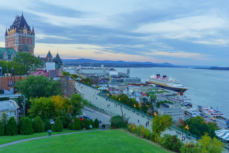 Quebec City, Canada - September 27, 2018: Sunset view of the old town and the Saint Lawrence River from the citadel, with locals and visitors, Quebec City, Quebec, Canada