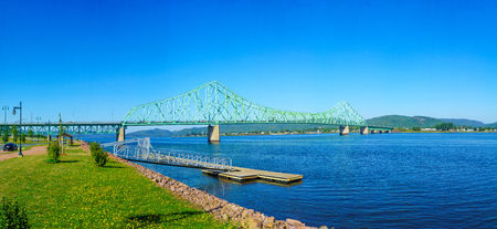 Panoramic view of the J.C. Van Horne Bridge, crossing the Restigouche River between Campbellton, New Brunswick and Pointe-a-la-Croix, Quebec. Canada