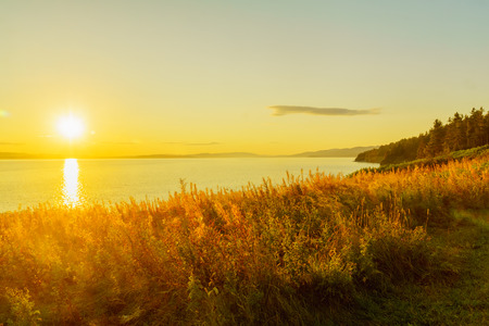 Sunset view of shore and ocean in the south sector of Forillon National Park, Gaspe Peninsula, Quebec, Canada Stock Photo