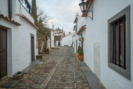 View of an alley in the historic village, in Monsaraz, Portugal Stock Photo