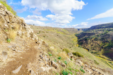 View of the remains of the ancient city and fortress of Gamla, with footpath and landscape. Golan Heights, Northern Israel