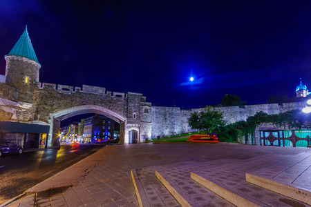 Night view of the Porte Saint-Jean Gate in Quebec City walls,  Quebec, Canada