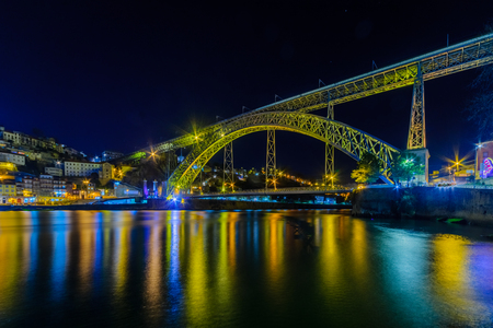 Night view of The Dom Luis I Bridge, and the Ribeira (riverside), in Porto, Portugal