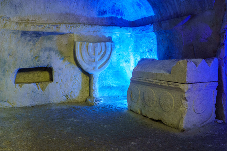 Sarcophagus (Roman period coffin) and a carved Menorah, in a Jewish burial cave, in Bet Shearim National Park (Jewish Necropolis), Northern Israel