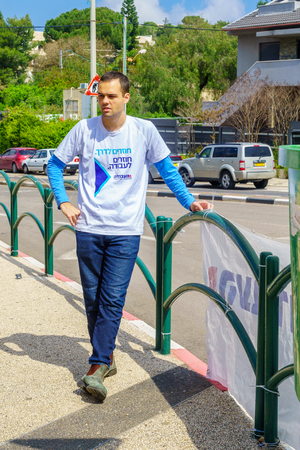 Haifa, Israel - April 05, 2019: Political activist in Ziv square, 4 days before the 2019 elections, in Haifa, Israel Editorial