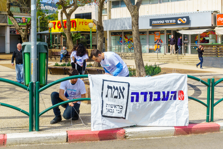 Haifa, Israel - April 05, 2019: Political activists and other people in Ziv square, 4 days before the 2019 elections, in Haifa, Israel