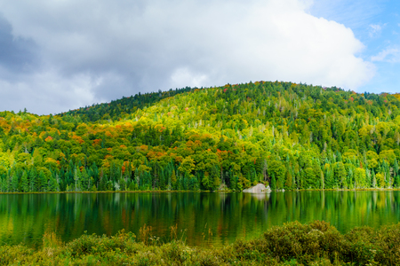 View of Lauzon lake and fall foliage colors, in Mont Tremblant National Park, Quebec, Canada