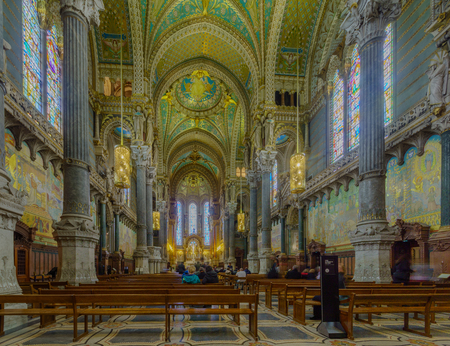Lyon, France - May 08, 2019: The interior of Notre-Dame basilica, with visitors, in Old Lyon, France Editorial