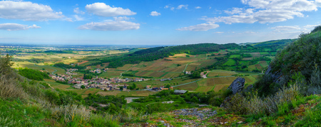 Panoramic landscape of vineyards and countryside, viewed from the Rock of Solutre (la roche), in Saone-et-Loire department, Burgundy, France