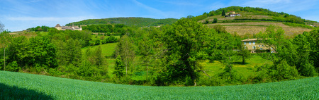 Panoramic landscape of vineyards and countryside, with Chateau de Varennes, in Beaujolais, Rhone department, France
