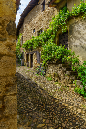 View of an alley in the medieval village Perouges, Ain department, France