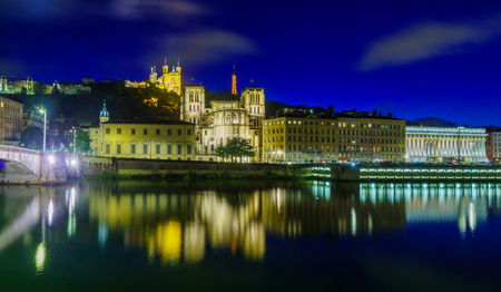 Night view of the Saone river, the Saint-Jean cathedral, and Notre-Dame basilica, in Lyon, France Stok Fotoğraf