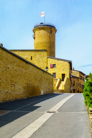 Street in the medieval village Oingt, and the keep tower, in Beaujolais, Rhone department, France
