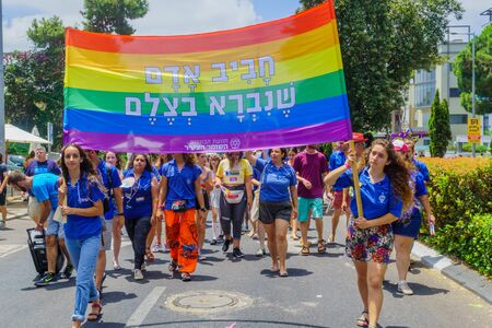 Haifa, Israel - June 28, 2019: People with protest signs in the annual pride parade of the LGBT community, in the streets of Haifa, Israel Editorial