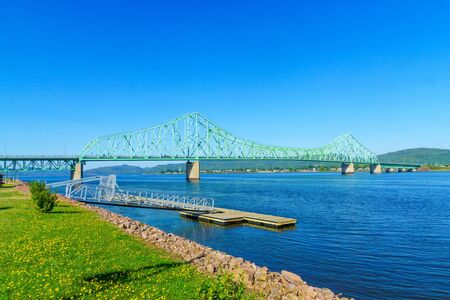 View of the J.C. Van Horne Bridge, crossing the Restigouche River between Campbellton, New Brunswick and Pointe-a-la-Croix, Quebec. Canada Stock Photo
