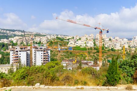 Haifa, Israel - July 12, 2019: Construction site of apartment buildings, with workers. Its an urban renewal project. Haifa, Israel