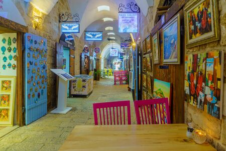 Acre, Israel - July 08, 2019: Scene of the restored Turkish Bazaar, with local businesses, locals and visitors, in the old city of Acre (Akko), Israel