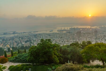 Sunrise view of the downtown, the port, the bay and the Bahai Shrine, in Haifa, Northern Israel