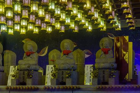 Miyajima, Japan - October 13, 2019: View of lanterns and Buddhistic statues in the Daisho-in temple complex, in Miyajima (Itsukushima) Island, Japan