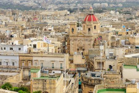 Victoria, Malta - April 11, 2012: Skyline view of the city of Victoria, and the St. Georges Basilica, Gozo Island, Malta Editorial