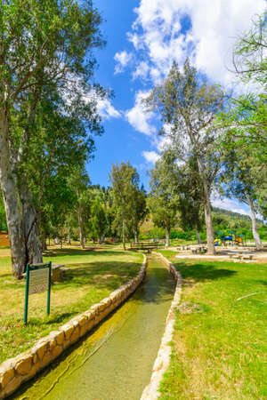 Gideona, Israel - May 06, 2020: View of a picnic area, water canals and trees in Maayan Harod National Park. Northern Israel