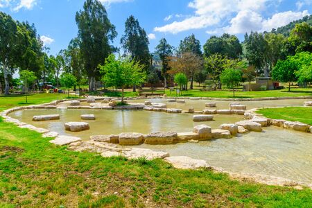 View of a wading pool in Maayan Harod National Park, and the slopes of Mount Gilboa. Northern Israel