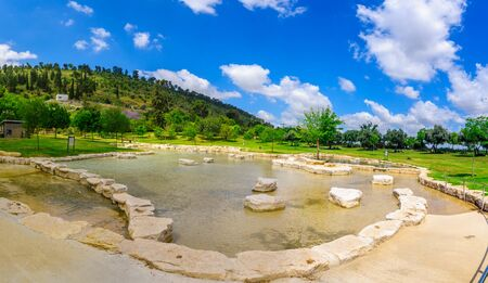 Panoramic view of a wading pool in Maayan Harod National Park, and the slopes of Mount Gilboa. Northern Israel Фото со стока